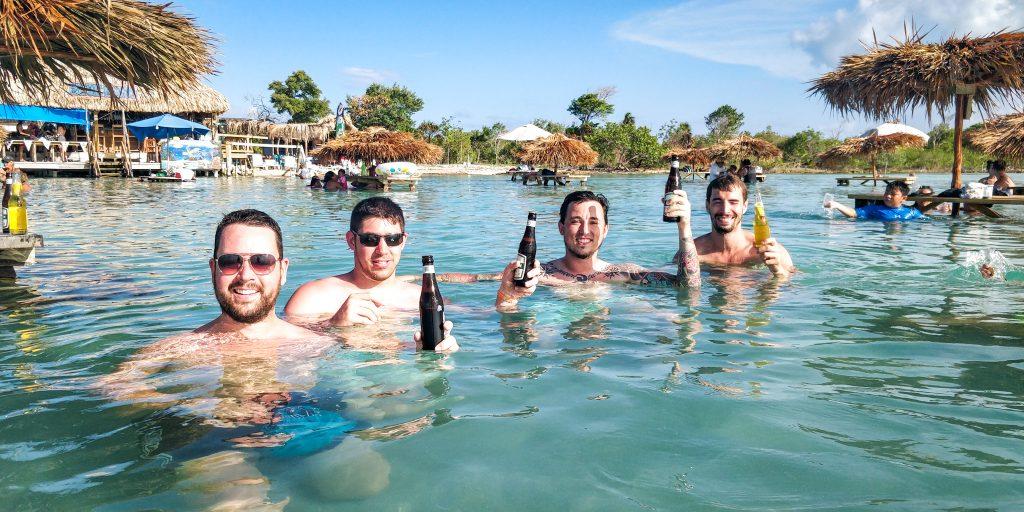 Boys drinking Belikins at Secret Beach