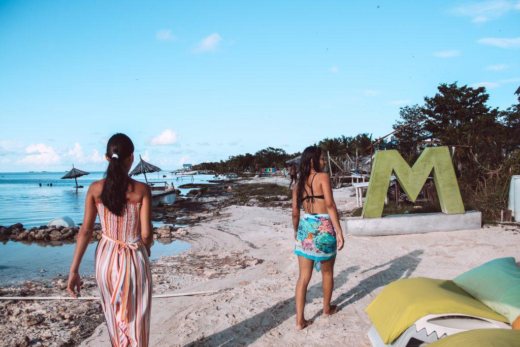 Drift Inn Guests Walking Secret Beach Ambergris Caye