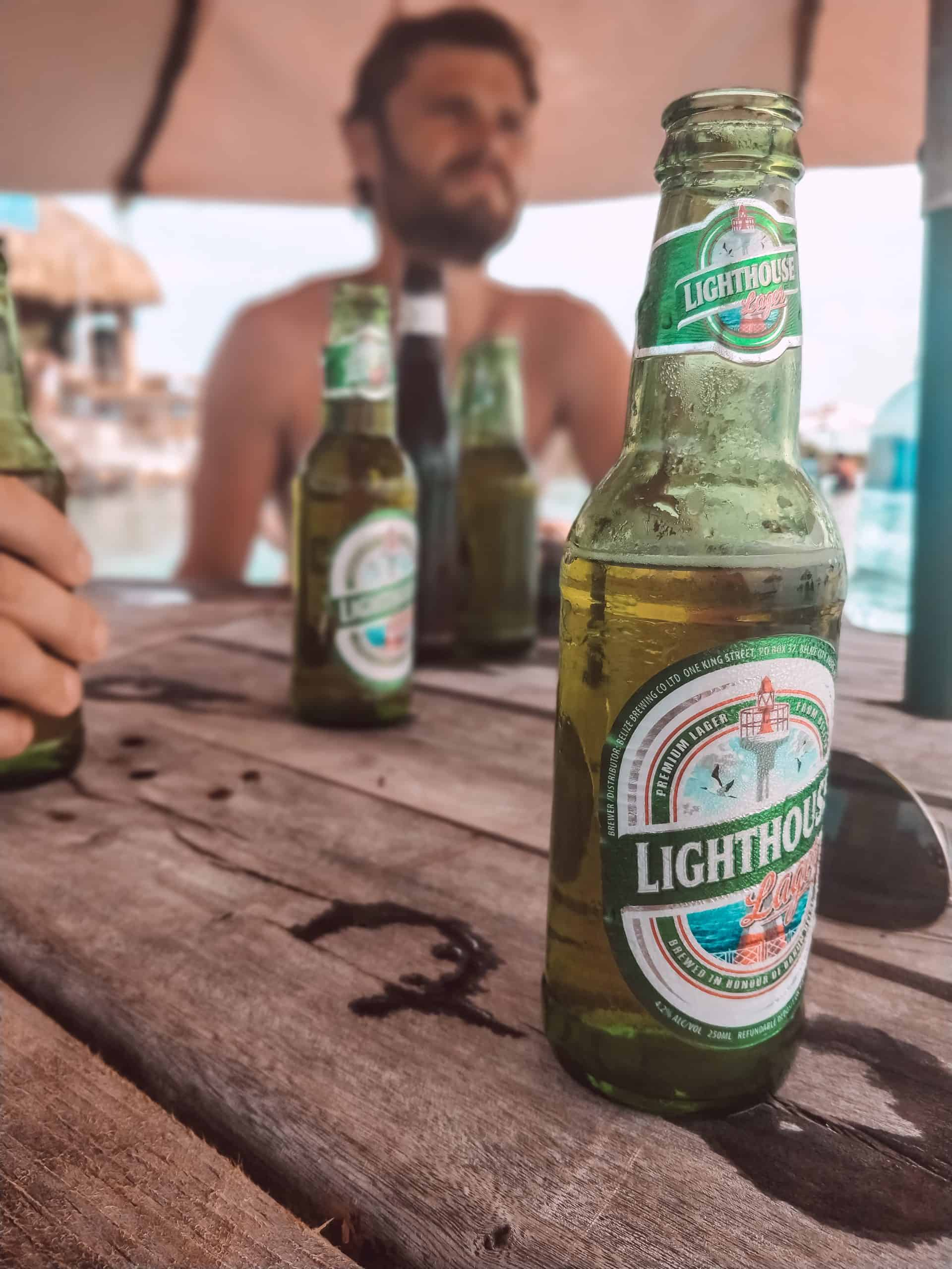 Lighthouse beers on a table in San Pedro, Belize